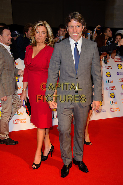 Melanie Bishop &amp; John Bishop<br /> The Daily Mirror's Pride of Britain Awards arrivals at the Grosvenor House Hotel, London, England.<br /> 7th October 2013<br /> full length grey gray suit red dress married husband wife<br /> CAP/CJ<br /> &copy;Chris Joseph/Capital Pictures