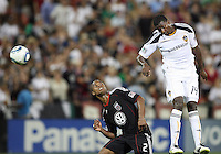 Julius James #2 of D.C. United watches Edson Buddle #14 of the Los Angeles Galaxy get to a header during an MLS match at RFK Stadium on July 18 2010, in Washington D.C. Galaxy won 2-1.