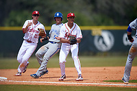 Indiana Hoosiers third baseman Isaiah Pasteur (6) during a rundown as shortstop Brian Whilhite (11) backs up the play with base runner Mike Alescio (51) heading into third base during a game against the Seton Hall Pirates on March 5, 2016 at North Charlotte Regional Park in Port Charlotte, Florida.  Seton Hall defeated Indiana 6-4.  (Mike Janes/Four Seam Images)