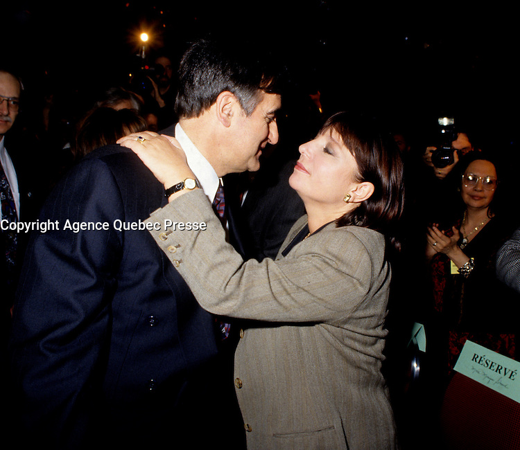Montreal (Qc) CANADA - File Photo - Jan 1996 -<br /> <br /> Lucien Bouchard,  Leader Parti Quebecois (from Jan 29, 1996 to March 2, 2001). seen in a file photo with Francine Simard<br /> <br /> After the Yes side lost the 1995 referendum, Parizeau resigned as Quebec premier. Bouchard resigned his seat in Parliament in 1996, and became the leader of the Parti Qu&Egrave;b&Egrave;cois and premier of Quebec.<br /> <br /> On the matter of sovereignty, while in office, he stated that no new referendum would be held, at least for the time being. A main concern of the Bouchard government, considered part of the necessary conditions gagnantes (&quot;winning conditions&quot; for the feasibility of a new referendum on sovereignty), was economic recovery through the achievement of &quot;zero deficit&quot;. Long-term Keynesian policies resulting from the &quot;Quebec model&quot;, developed by both PQ governments in the past and the previous Liberal government had left a substantial deficit in the provincial budget.<br /> <br /> Bouchard retired from politics in 2001, and was replaced as Quebec premier by Bernard Landry.