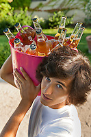 Young man carrying a bucket full of beers