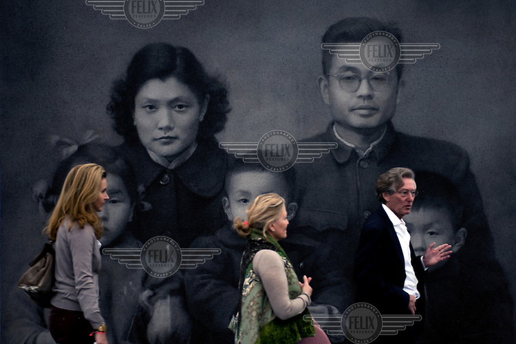 People walk past 'Our Parents' by Zhang Huan at the Frieze Masters art fair.  ..
