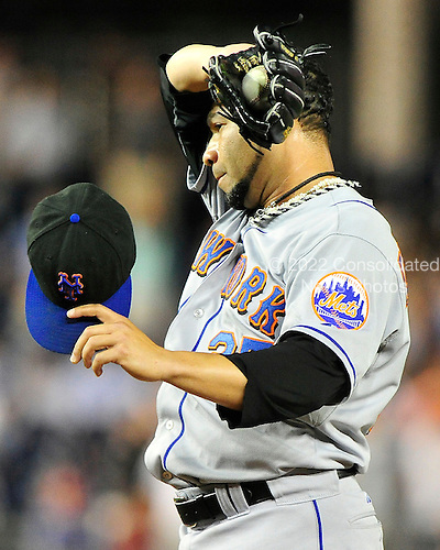 New York Mets pitcher Pedro Feliciano (25) wipes his brow between pitches in the ninth inning against the Washington Nationals at Nationals Park in Washington, D.C. on Thursday, July 1, 2010.  The Nationals won on a walk-off sacrifice fly 2 - 1..Credit: Ron Sachs / CNP.(RESTRICTION: NO New York or New Jersey Newspapers or newspapers within a 75 mile radius of New York City)