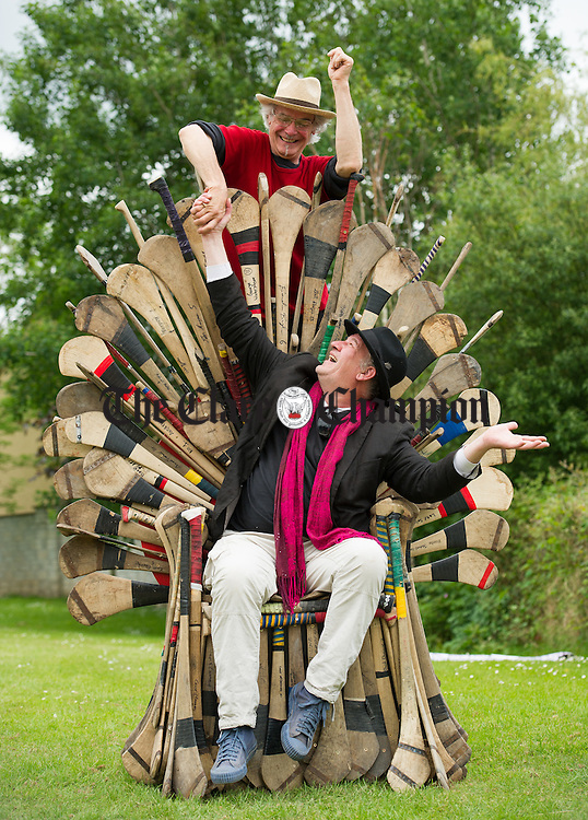 Paul Berg and Nard Slabbers, above, on the Throne of GAAmes which was on display during the Iniscealtra Arts Festival in Mountshannon. Photograph by John Kelly.