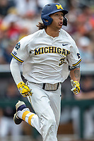 Michigan Wolverines outfielder Jordan Brewer (22) runs to first base during Game 1 of the NCAA College World Series against the Texas Tech Red Raiders on June 15, 2019 at TD Ameritrade Park in Omaha, Nebraska. Michigan defeated Texas Tech 5-3. (Andrew Woolley/Four Seam Images)