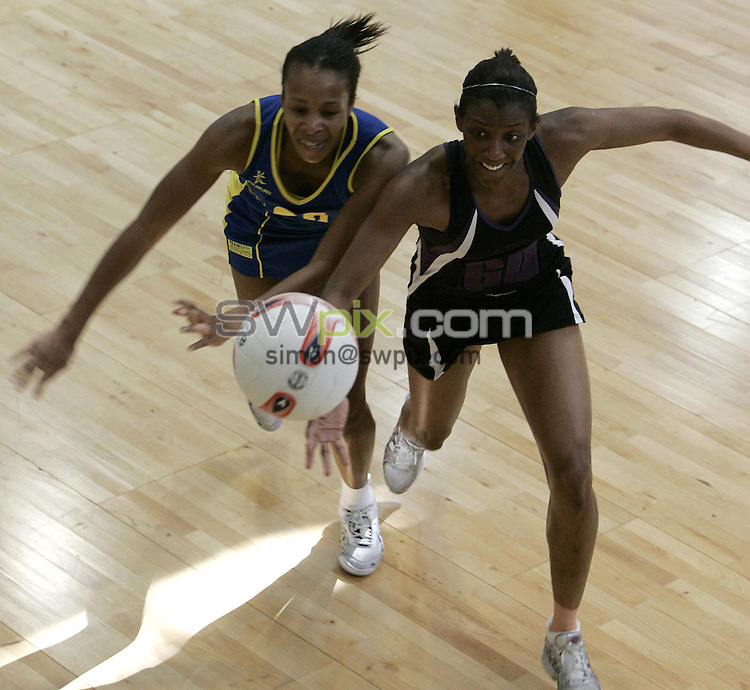 PIC BY PHIL SEARLE/SWPIX : 2006 figleaves.com Superleague Final, Guildford Spectrum.Pamela Cookey, Janet Colbourne ....03/06/06....Janet Colbourne of Mavericks and Pamela Cookey of TeamBath battle for the ball in the first ever figleaves.com Superleague Final played at the Guildford Spectrum. TeamBath won the match 43-35(Photo: Phil Searle)
