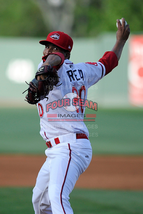 Relief pitcher Yunior Ortega (20) of the Greenville Drive bats in a game against the Delmarva Shorebirds on Monday, April 29, 2013, at Fluor Field at the West End in Greenville, South Carolina. Delmarva won, 6-5 in game one of a doubleheader. (Tom Priddy/Four Seam Images)