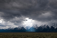 sunlight breaking through clouds on the Tetons