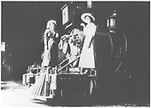Two ladies posing on the pilot of D&amp;RG #40, apparently inside the roundhouse.<br /> D&amp;RG  Durango, CO