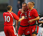 Michael Higdon congratulated by Billy Mehmet and Steven Thomson
