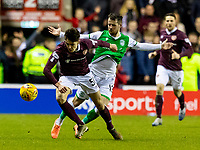 3rd March 2020; Easter Road, Edinburgh, Scotland; Scottish Premiership Football, Hibernian versus Heart of Midlothian; Aaron Hickey of Hearts and Marc McNulty of Hibernian compete for possession of the ball