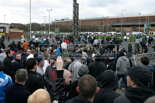 Having broken through police lines, hundreds of EDL supporters surge into Dudley town centre.