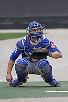 Catcher Matt Wallach #29 of the Chattanooga Lookouts warms up a pitcher in the bullpen before  a game against the Carolina Mudcats on May 22, 2011 at Five County Stadium in Zebulon, North Carolina. Photo by Robert Gurganus/Four Seam Images.