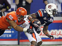 ATLANTA, GA - DECEMBER 31: Ray Keys #86 of the Virginia Cavaliers tackles Quan Bray during the 2011 Chick Fil-A Bowl at the Georgia Dome on December 31, 2011 in Atlanta, Georgia. Auburn defeated Virginia 43-24. (Photo by Andrew Shurtleff/Getty Images) *** Local Caption *** Quan Bray;Ray Keys