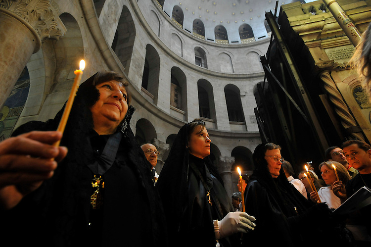 Christians on a procession during an Easter Mass at the Church of the Holy Sepulchre in Jerusalem.