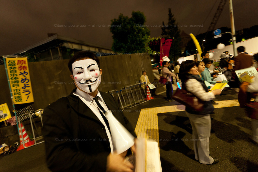 An anti Nuclear protestor wearing a Guy Fawkes mask at the Friday night protests around the parliament building in Nagatacho, Tokyo, Japan Friday October 12th 2012