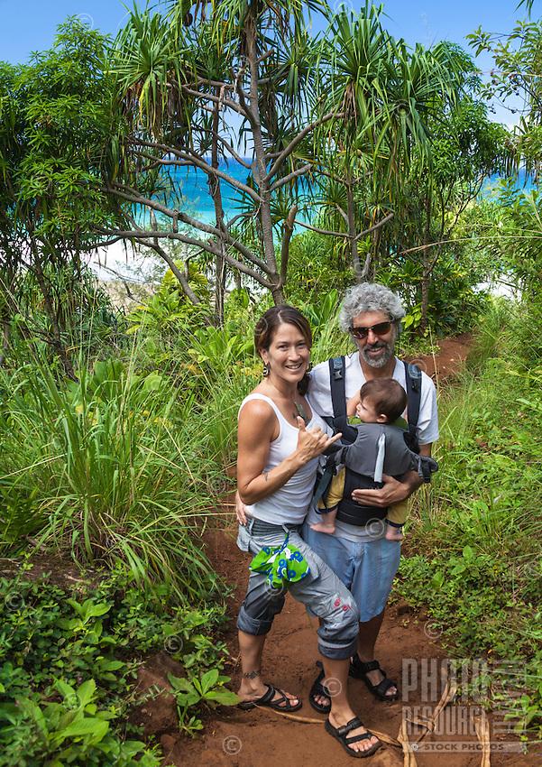 Hikers with their baby on the Kalalau Trail near Hanakapi'ai Beach, Kaua'i.
