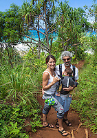Hikers with their baby on the Kalalau Trail near Hanakapi'ai Beach, Kaua'i.