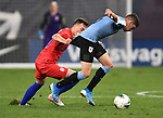 Corey Baird (left) of the United States and Federico Valverde of Uruguay vie for the ball during an international friendly game  on September 10, 2019 at Busch Stadium in St. Louis, Missouri USA<br /> AFP Photo by Tim VIZER