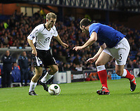 Danny Carmichael takes on Lee Wallace in the Rangers v Queen of the South Quarter Final match in the Ramsdens Cup played at Ibrox Stadium, Glasgow on 18.9.12.