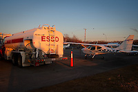 The sun set on a Cesna 172 Skyhawk aircraft matriculated C-FZKA and a Esso oil truck at the Quebec City Jean Lesage International Airport, also known as Jean Lesage International Airport (French: Aeroport international Jean-Lesage de Quebec, or Aeroport de Quebec) (IATA: YQB, ICAO: CYQB) November 11, 2009.