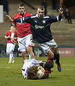 Deveronvale goalkeeper Darren McConnachie saves at the feet of Raith's Greig Spence  ...