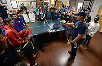 NWA Democrat-Gazette/ANDY SHUPE<br /> Andrew Horton (right) with the Fayetteville Fire Department speaks Wednesday, Nov. 6, 2019, to a group of student fire marshals at the department's central fire station. Schools in the district appoint student fire marshals who assist staff and students during fire drills and emergency situations by guiding people to exits and ensuring that doors are closed.