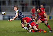 24th March 2018, AJ Bell Stadium, Salford, England; Aviva Premiership rugby, Sale Sharks versus Worcester Warriors; wMike Haley of Sale Sharks passes the ball as he is tackled by Josh Adams of Worcester Warriors