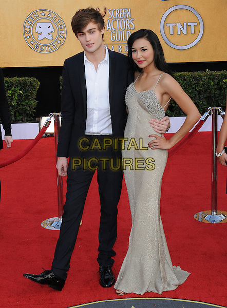 DOUGLAS BOOTH & NAYA RIVERA.17th Annual Screen Actors Guild Awards held at The Shrine Auditorium, Los Angeles, California, USA..January 30th, 2011.SAG arrivals full length beige dress hand on hip silver beads beaded black suit   white shirt.CAP/RKE/DVS.©DVS/RockinExposures/Capital Pictures.