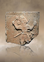 Hittite monumental relief sculpture of a man with an axe in one hand about to use it to kill a lion he is holding updide down in his other hand. Late Hittite Period - 900-700 BC. Adana Archaeology Museum, Turkey.