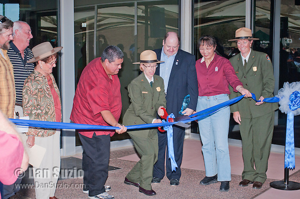 Park Superintendent Sarah Craighead cuts the ribbon at the Grand Re-Opening of the Furnace Creek Visitor Center in Death Valley National Park, California, on November 4, 2012. Standing with her are (l to r) Scott Smith of the Death Valley Conservancy; Rich Jones, General Manager of Furnace Creek Resort; Bev Malley, President of the Death Valley 49ers; George Gholson, Chairman of the Timbisha Shoshone Tribe; David Blacker, Executive Director of the Death Valley Natural History Association; Xiauling Liu, President and CEO of Rio Tinto Minerals; and Chris Lehnertz, Pacific West Regional Director of the National Park Service.