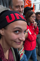Switzerland. Canton Ticino. Bellinzona. The wave of national protest in the construction industry began on October 15 in Ticino. A woman with an UNIA headscarf came to support 3000 masons from Ticino who have interrupted their work to meet in Bellinzona and demand that retirement be maintained at 60. In addition to retirement at 60, the fight against wage dumping and longer working hours are at the heart of the demands. Unia and OCST unions said in a joint statement that masons have had enough after a year of blocking negotiations and blackmail. The workers and their unions have therefore decided to start a national protest. If no agreements are found between workers and constructions companies, a strike might occur in the near future. 15.10.2018 © 2018 Didier Ruef