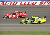 Oct. 11, 2009; Fontana, CA, USA; NASCAR Sprint Cup Series driver Kasey Kahne (9) races alongside Matt Kenseth (17) during the Pepsi 500 at Auto Club Speedway. Mandatory Credit: Mark J. Rebilas-