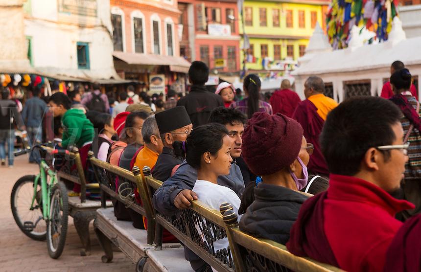 Kathmandu Nepal two monks and Man and old woman praying on bench at the Boudhanath Stupa  3  4   5