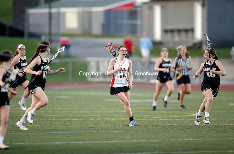 Southbury, CT- 07 May 2015-050715CM10-  Pomperaug's Caroline Dwyer carries the ball against Joel Barlow defenders during their SWC lacrosse matchup in Southbury on Thursday.   Christopher Massa Republican-American