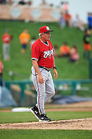 Carolina Mudcats manager Rocket Wheeler (18) walks to the mound during a game against the Frederick Keys on June 4, 2016 at Nymeo Field at Harry Grove Stadium in Frederick, Maryland.  Frederick defeated Carolina 5-4 in eleven innings.  (Mike Janes/Four Seam Images)