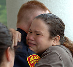SHIRLEY, NY-FRIDAY, AUGUST 10, 2007: Stacie DeAngelo, daughter of Maria Giambalvo, at the 7th Precinct in Shirley on Friday August 10, 2007 to thank SCPD P.O. Joseph Riess . This morning Riess rescued Maria Giambalvo, 74, from a fire that gutted her Mastic home.<br /> Newsday / Jim Peppler