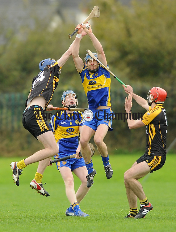 Niall O Connor and David Barrett of Newmarket in action against Aonghus Keane and Niall Keane of Ballyea during their semi-final at Clarecastle. Photograph by John Kelly.