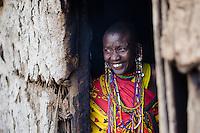 A widow in the doorway of her hut in Maji Moto's widow's village