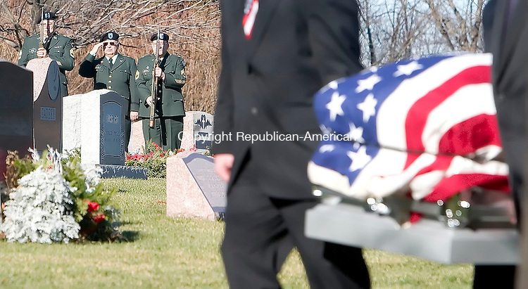 SEYMOUR, CT- 19 DEC 06- 121906JT06- <br /> An honor guard detail stands at a distance as pallbearers carry the coffin of Walter Krauchick during his funeral at Mountain Meadows Cemetery in Seymour on Tuesday. Krauchick was a retired Gunnery Sargeant in the US Marine Corps and served in WWII, Korea, and Vietnam during his 24 years of service. <br /> Josalee Thrift Republican-American
