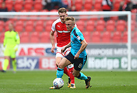Kyle Dempsey of Fleetwood Town and Michael Smith of Rotherham United  during the Sky Bet League 1 match between Rotherham United and Fleetwood Town at the New York Stadium, Rotherham, England on 7 April 2018. Photo by Leila Coker.