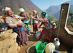 Women laugh together as they gather at a community water tap in Salang, a village in the Dhading District of Nepal where Dan Church Aid, a member of the ACT Alliance, has provided a variety of support to local villagers in the wake of a devastating 2015 earthquake. The village's water system was destroyed by the quake, forcing women to walk two hours or more to a nearby river to fetch water. Working with a local organization, the Forum for Awareness and Youth Activity, the ACT Alliance rebuilt the village's water system.