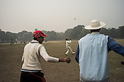 Young cricketers from the Calcutta Parsee Club seen practicing during their regular practice session at the maidan in Kolkata, West Bengal, India.