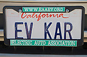 A close up of 'EV Kar' (Electric Vehicle Car) vehicle license plate. At an Electric Vehicle Rally in Palo Alto. Hosted by the Silicon Valley Chapter of the Electric Auto Association. Palo Alto, California, USA