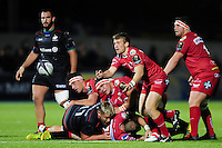 Jonathan Evans of the Scarlets passes the ball. European Rugby Champions Cup match, between Saracens and the Scarlets on October 22, 2016 at Allianz Park in London, England. Photo by: Patrick Khachfe / JMP