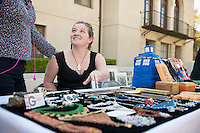 People browse tables at Handmade Oxy, the first ever one day sale of art by Oxy students, faculty and staff. Featuring live music,jewelry, paintings, wearables, stationary and more in the JSC quad, April 16, 2015.  <br /> (Photo by Marc Campos, Occidental College Photographer)