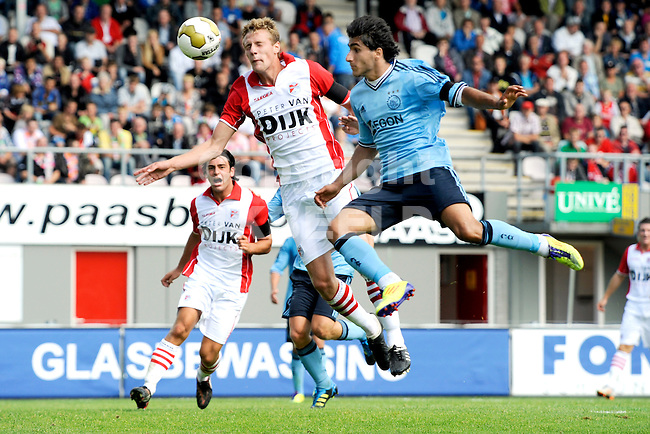 EMMEN - FC Emmen - Ajax voorbereiding  seizoen 2011-2012 , 09-07-2011 Emmen speler Kevin Gortz (l)  in duel met Aajax speler Aras Ozbiliz.