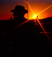 Silhouetted man with hat.Tenerife, Canary Islands