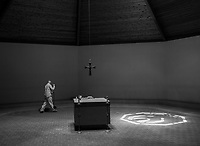 """Brother Bryan sweeps the sanctuary during a quiet afternoon on July 12, 2018. <br /> <br /> """"What drew me was the routine of the daily life,"""" he says. """"I never dreamed of being a monk or a hermit. That is not what I wanted to do. I just knew I wanted to do God's will."""""""