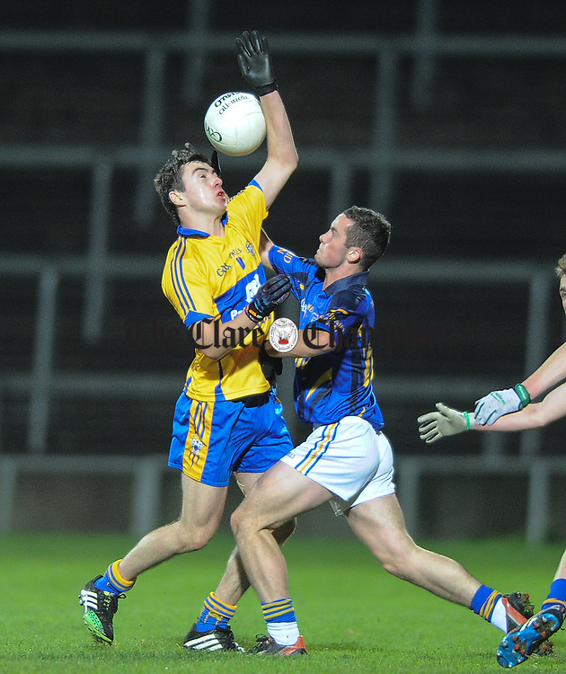 Niall Mc Carthy of Clare in action against Conor Clancy of Tipperary during their U-17 Munster League final in The Gaelic Grounds. Photograph by John Kelly.